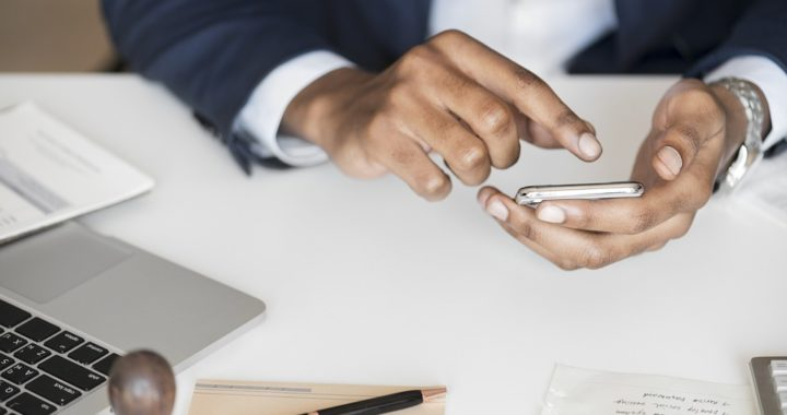 Hands of Black corporate worker using a calculator