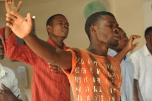 church members with hands in the air