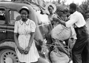 vintage photo of black family loading a vehicle