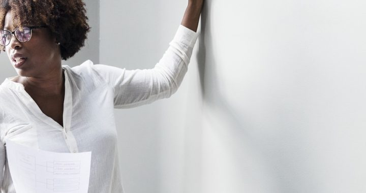 Teacher at dry erase board