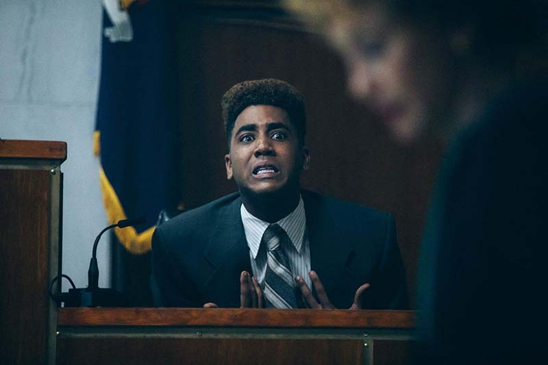 stressed black man in court being questioned