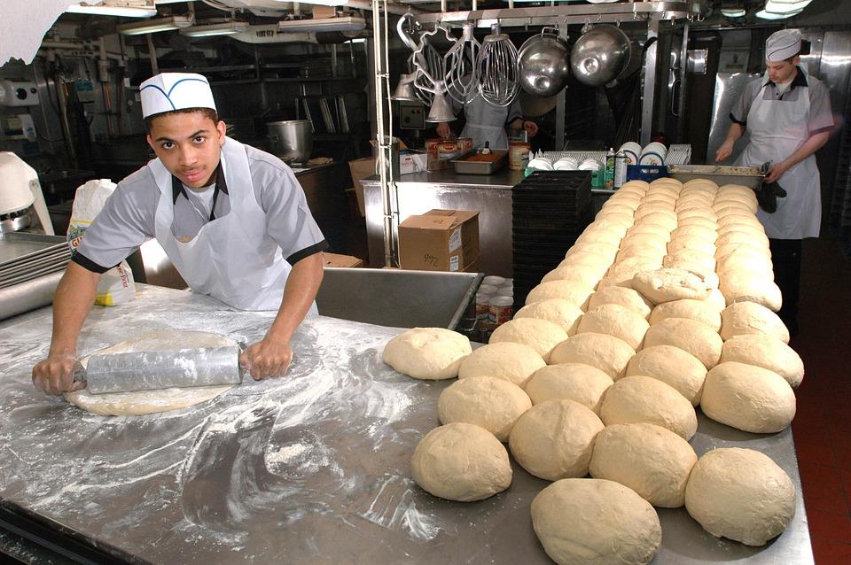 bakery workers preparing bread