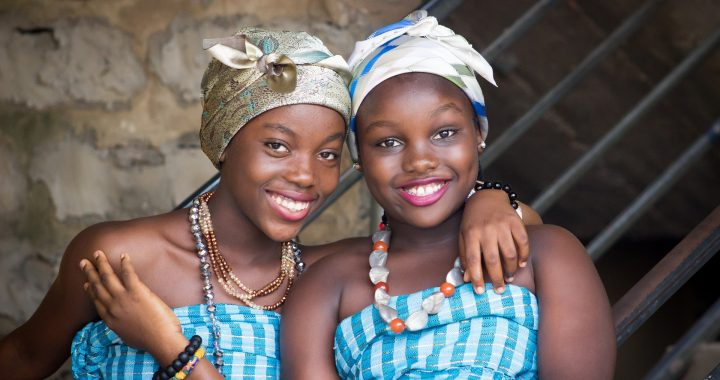 two young girls in colorful dress