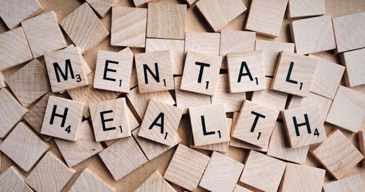 mental health spelled with scrabble board pieces
