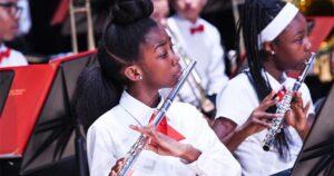 Kids playing flutes